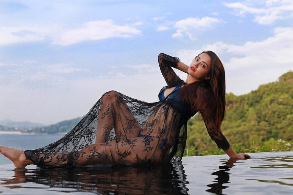 Photo of Surveen Chawla Photoshoot on the Beach, Pose in Bikini – Biography